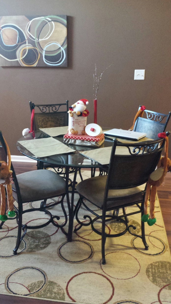 "Santa and his reindeer are ""hanging"" out on the chairs. I made the centerpiece! (so proud)"
